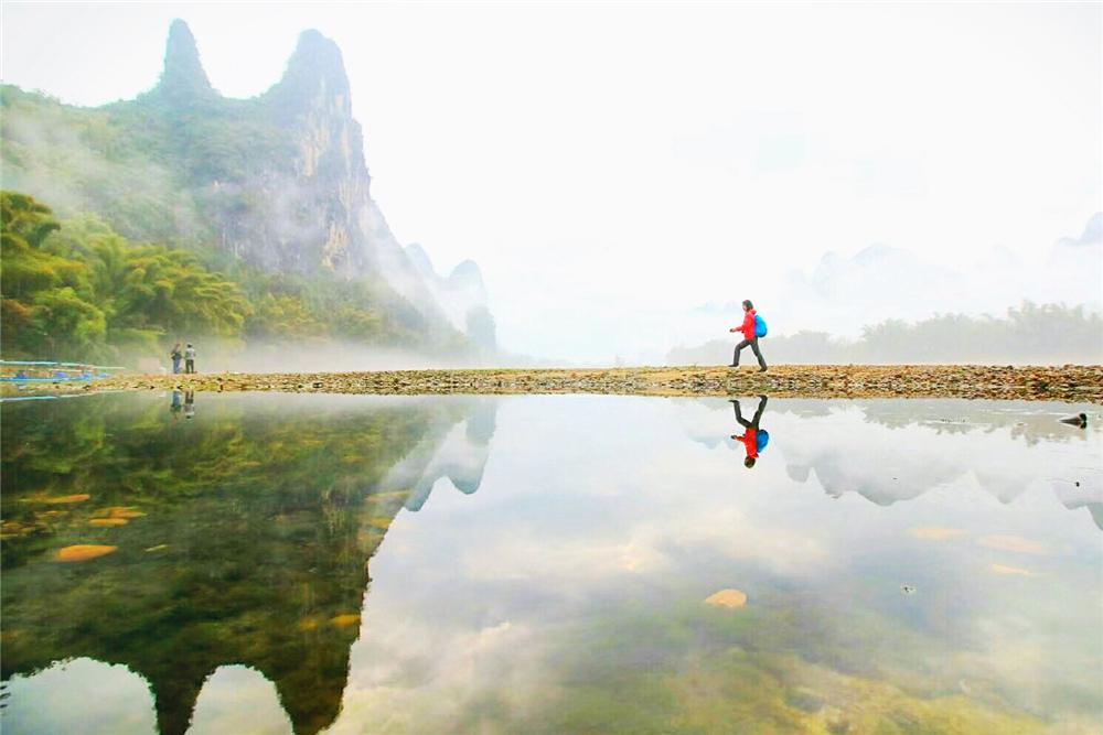 广西桂林7日深度游探知喀斯特地貌,十里画廊喀斯特地貌骑行、挑战喀斯特户外运动-飞拉达、探洞、溜索、速降、石头画创作、漓江徒步、竹筏漂流。